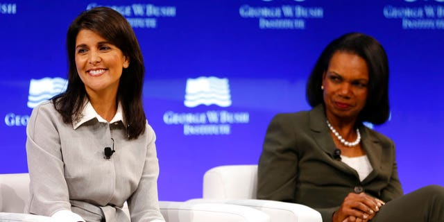 U.S. Ambassador to the United Nations Nikki Haley, left, and former U.S. Secretary of State Condoleeza Rice participate in a panel discussion at a forum sponsored by the George W. Bush Institute in New York, Thursday, Oct. 19, 2017. (AP Photo/Seth Wenig)