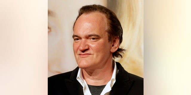 FILE - In this Oct. 8, 2016 file photo, director Quentin Tarantino poses for photographers at the opening ceremony of the 8th Lumiere Festival, in Lyon, central France. Tarantino says he knew about a few instances of improper conduct by producer Harvey Weinstein and wishes he had done more. Speaking to The New York Times in an interview published Thursday, Oct. 19, 2017, Tarantino expressed remorse for not having taken responsibility at the time. He says he knew first hand of Weinstein's conduct toward actress Mira Sorvino and another he declined to name. Sorvino and Tarantino were dating at the time. (AP Photo/Laurent Cipriani, File)