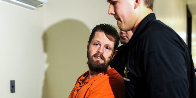 Doctors testified in court Wednesday that Oberhansley, shown being escorted through the Clark County Courthouse in 2015, was not fit to stand trial.