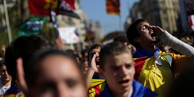Students shout out as they march during a protest against the Spanish government announcement of implementing the article 155 in the Catalonia region, in Barcelona, Spain, Thursday Oct. 26, 2017. The Catalan parliament is due to meet to discuss Spanish government's plans to remove the leaders of the regional government. (AP Photo/Emilio Morenatti)
