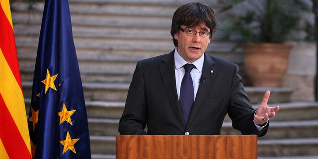 Carles Puidgemont, the ousted Catalan leader, called for peaceful protests amid Spain's action to disband the regional government.