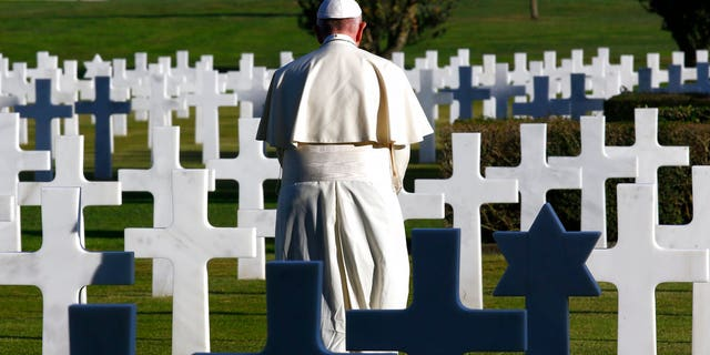 The mass was a celebration of All Souls Day, when Italians honor their dead. The pontiff said the venue, a cemetery, was a fitting place for an anti-war speech.