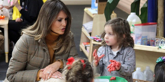 First Lady Melania Trump plays with children at Joint Base Elmendorf-Richardson, Alaska, on Nov. 10, 2017