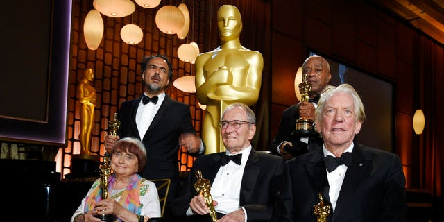 2017 Governors Awards honorees Agnes Varda, Alejandro Gonzales Inarritu, Owen Roizman, Charles Burnett and Donald Sutherland pose with their Oscars following a ceremony at The Ray Dolby Ballroom