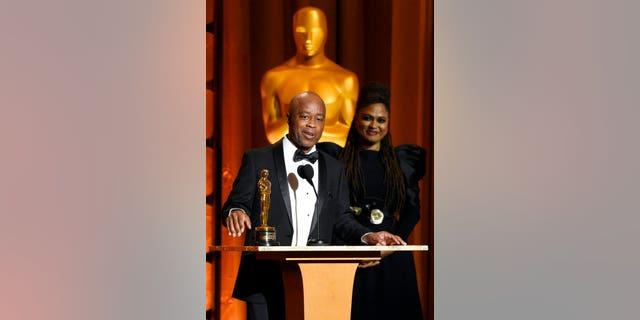 Film director Charles Burnett accepts an honorary Oscar.
