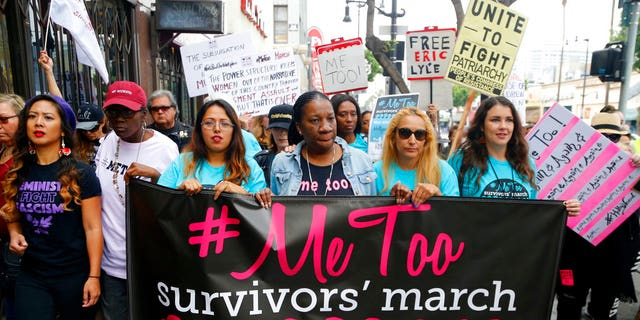 Participants march against sexual assault and harassment at the #MeToo March in the Hollywood section of Los Angeles on Sunday.