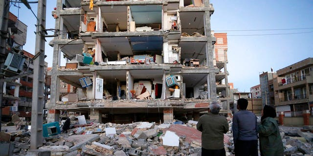 People looked at destroyed buildings after an earthquake at the city of Sarpol-e-Zahab in western Iran on Monday.