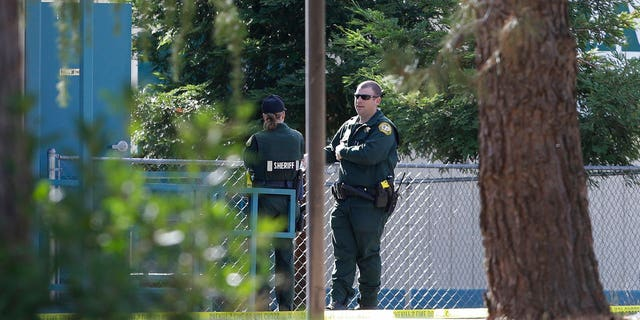 Law enforcement officers are seen Tuesday at an elementary school in the community of Rancho Tehama Reserve.