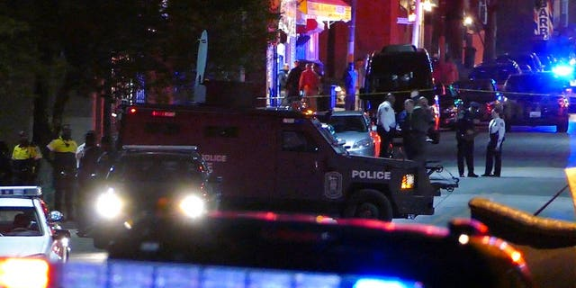 Baltimore police said in a tweet that one of their officers was shot Wednesday evening.