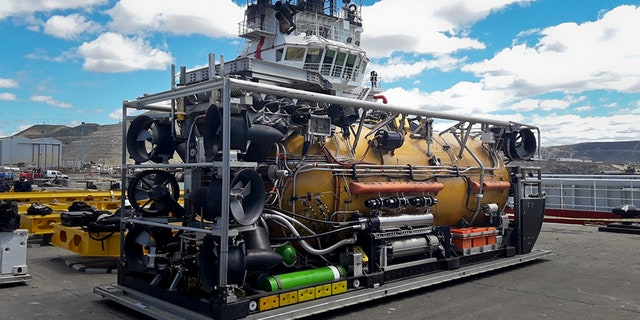 A U.S. Navy pressurized rescue module sits on the dock before being loaded on the Sophie Siem ship in Comodoro Rivadavia port.