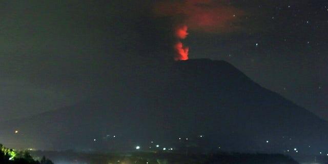 A view of the Mount Agung volcano erupting, in Karangasem, Bali island, Indonesia, early Sunday.