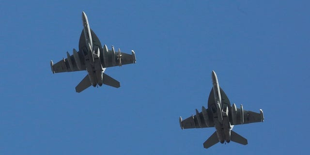 U.S. Air Force EA-18G Growler fighter jets fly over the Osan U.S. Air Base in Pyeongtaek, South Korea.