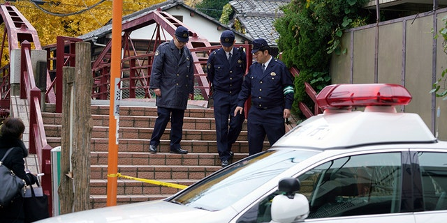 Tokyo Metropolitan Police said the motive for the attack was unclear, though Japanese media reported a family feud may have been at fault.