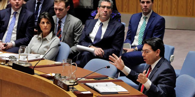 Israel's U.N. Ambassador Danny Dannon, right, speaks in the Security Council as U.S. Ambassador Nikki Haley, left, listens at United Nations headquarters, Friday, Dec. 8, 2017. (AP Photo/Richard Drew)
