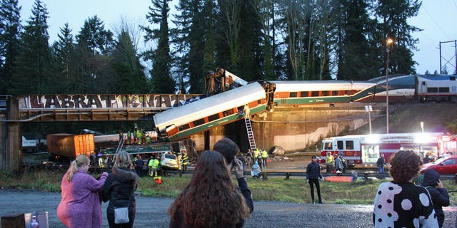Federal investigators are working to determine if the Amtrak engineer operating the train that derailed in Washington Monday morning was distracted by a second person in the train car.