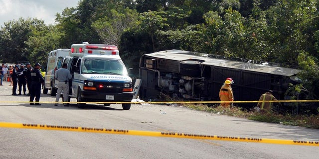 The bus carrying cruise ship passengers to the Mayan ruins at Chacchoben in eastern Mexico flipped over on a highway early Tuesday.