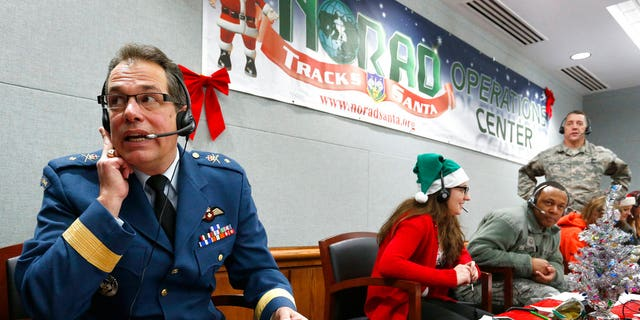 Hundreds of military and civilian volunteers at NORAD are estimated to field more than 100,000 calls this year throughout Christmas Eve, from children from all over the world eager to hear about Santa's progress.