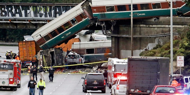 Several Amtrak train cars fell over the overpass and onto Interstate 5 in Washington state after derailing.