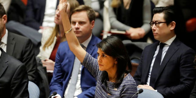 U.S. Ambassador to the United Nations Nikki Haley votes in favor of a resolution proposing sanctions against North Korea, Dec. 22, 2017.