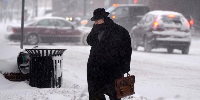 A man braving the frigid temperatures in Syracuse, N.Y.