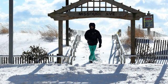 A man near an entryway along the Atlantic City Boardwalk in New Jersey.