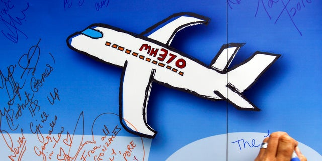 In this March 2016 file photo, well wishers have written on a wall of hope during a remembrance event for the missing Malaysia Airlines Flight 370 in Kuala Lumpur, Malaysia. The Malaysian government has approved a new attempt to find the wreckage of Malaysia Airlines Flight 370 in the Indian Ocean.