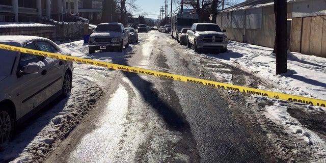 Crime tape stretches across a road near the scene of the deadly Harrisburg shooting.
