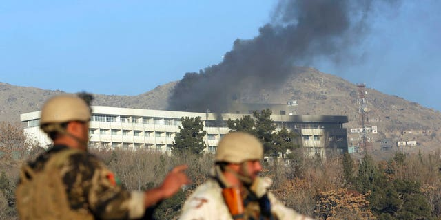 Black smoke rises from the Intercontinental Hotel in Kabul, Afghanistan, after gunman attacked the property last week.