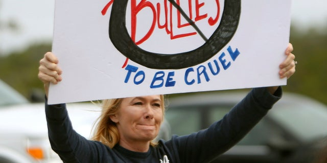 On Monday, concerned parents and family members protested bullying near Surfside Middle School, in Panama City Beach, Fla.
