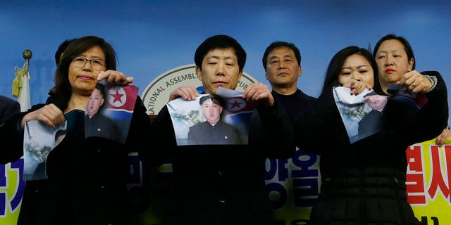 South Korean protesters ripped up photos of Kim Jong Un in protest ahead of the Winter Olympics.