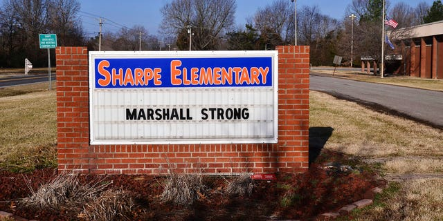 """A sign displays """"Marshall Strong"""" at Sharpe Elementary in Marshall County on Wednesday, Jan. 24, 2018, in Sharpe, Ky., a day after a fatal school shooting at nearby Marshall County High School."""
