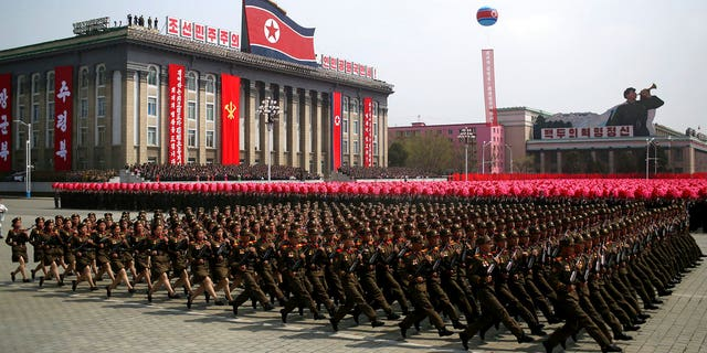 FILE - In this April 15, 2017, file photo, soldiers march across Kim Il Sung Square during a military parade in Pyongyang, North Korea. North Korea is preparing to stage a major event to mark the 70th anniversary of the founding of its military on Feb. 8, 2018 - just one day before the opening ceremony of the Pyeongchang Winter Olympics in South Korea. (AP Photo/Wong Maye-E, File)