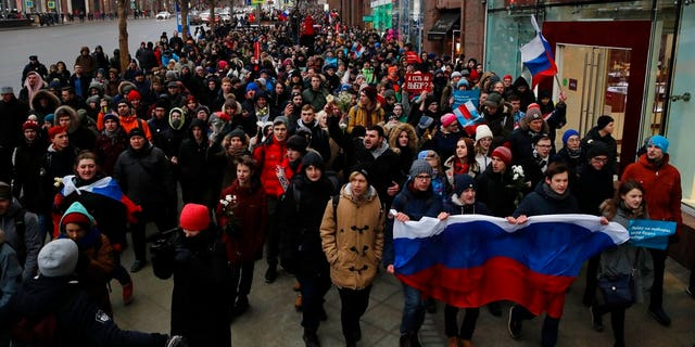 Protesters shout slogans during a rally in Moscow, Sunday, Jan. 28, 2018 against Russia's Central Election Commission's decision to ban the opposition leader Alexei Navalny presidential candidacy.