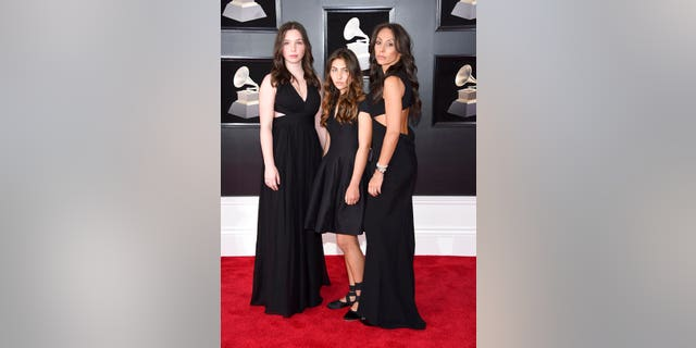 Lily Cornell, from left, and Toni Cornell, daughters of the late Chris Cornell, and Vicky Karayiannis, Cornell's widow, arrive at the 60th annual Grammy Awards at Madison Square Garden.