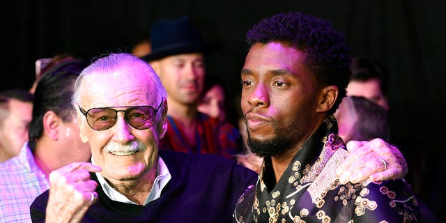 """Stan Lee, left, creator of the """"Black Panther"""" superhero, poses with Chadwick Boseman, star of the new """"Black Panther"""" film, at the premiere at The Dolby Theatre on Monday, Jan. 29, 2018, in Los Angeles."""