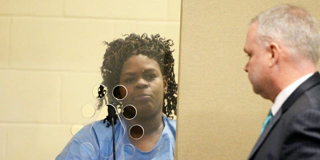 Latarsha Sanders, 43, was arraigned Tuesday on two counts of murder.