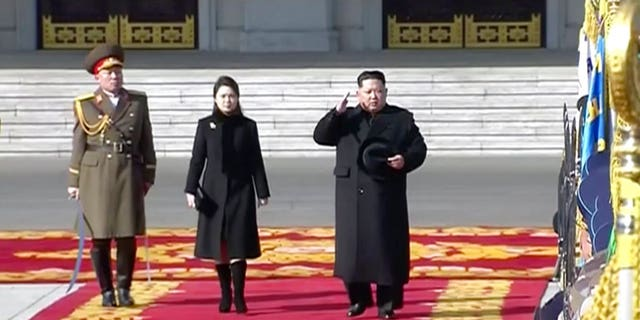 Kim Jong Un and his wife Ri Sol Ju walked the red carpet at the start of the parade.