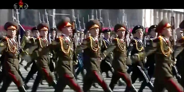 The goose-stepping troops marched through Kim Il Sung's square for the parade