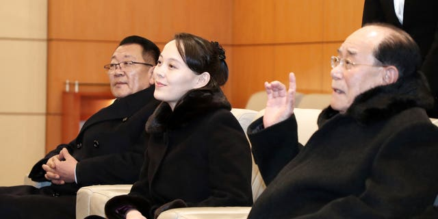 Kim Yo Jong, center, sits with Kim Yong Nam, North Korea's nominal head of state, and Choe Hwi, left, chairman of the North Korea's National Sports Guidance Committee, at the Incheon International Airport in Incheon, South Korea.