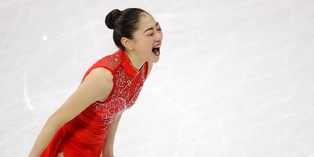 Mirai Nagasu of the United States celebrates after her performance in the women's free skate during the team competition at the 2018 Winter Olympics. She became the first American woman to land the triple axel in the Olympics.
