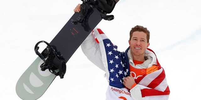 Gold medal winner Shaun White, of the United States, celebrates after the men's halfpipe finals at Phoenix Snow Park