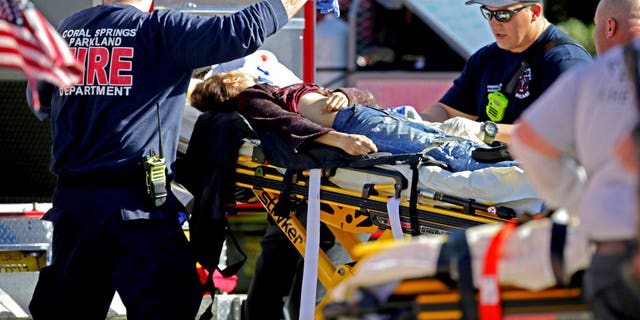Medical personnel tend to a victim following a shooting at Marjory Stoneman Douglas High School.