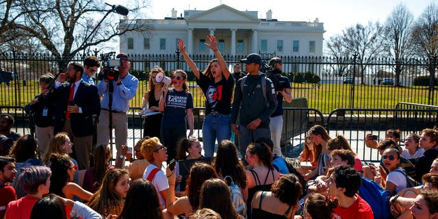 Demonstrators take part in a student protest for gun control legislation in front of the White House, Wednesday, Feb. 21, 2018, in Washington.