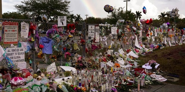 A memorial is placed outside Marjory Stoneman Douglas High School.