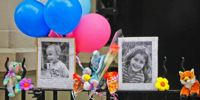 In this Oct. 27, 2012, file photo, photographs of 6-year-old Lucia Krim and her 2-year-old brother, Leo, are displayed alongside balloons and stuffed animals at a memorial outside the apartment building where they lived in New York.