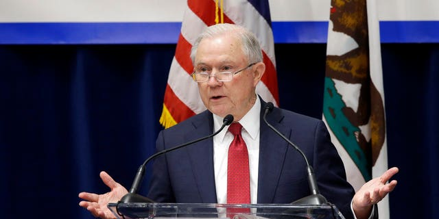 U.S. Attorney General Jeff Sessions addresses the California Peace Officers' Association at the 26th Annual Law Enforcement Legislative Day, Wednesday, March 7, 2018, in Sacramento, Calif. Sessions told law enforcement officers at the conference Wednesday that the Justice Department sued California because state laws are preventing federal immigration agents from doing their jobs. (AP Photo/Rich Pedroncelli)