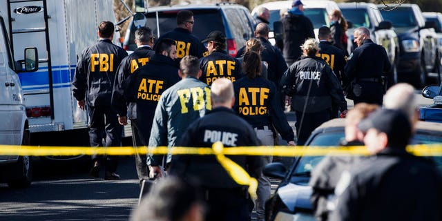 Authorities work on the scene of an explosion in Austin on March 12.
