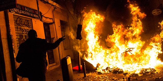 At least six people were arrested and nearly two dozen were injured after protesters clashed with police in Madrid.