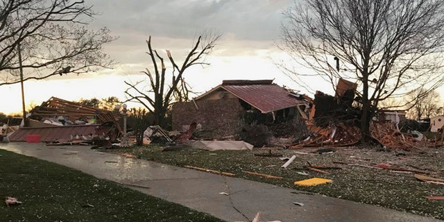 Severe storms that spawned tornadoes damaged homes and downed trees as they moved across the Southeast on Monday night.