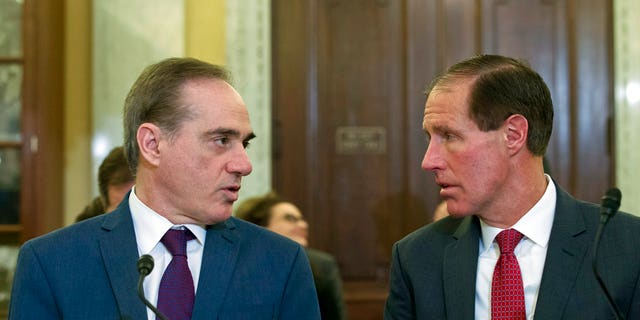 Veterans Affairs Secretary David Shulkin, left, speaks with Chief Financial Officer of the Department of Veterans Affairs Jon Rychalski during a hearing on budgets for veterans programs, before the Senate Committee on Veterans Affairs on Capitol Hill.